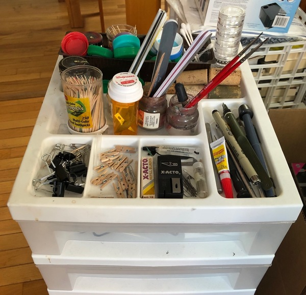 "My ""homely tools"" cart in my shop: toothpicks, safety pins, cotton swabs, binder clips, corks, bottle caps, and more."